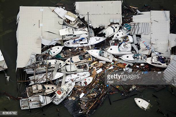 In this aerial photo boats and debris are piled up after Hurricane Ike made landfall overnight September 13 2008 in Galveston Texas Ike caused...