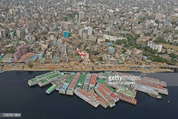 In this aerial photo boats are seen parked on the banks of the Buriganga River during a lockdown imposed to combat the spread of the Covid-19...
