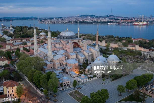 In this aerial photo from a drone Istanbul's famous Hagia Sofia and surrounding gardens and pathways are seen empty during a weekend lockdown across...