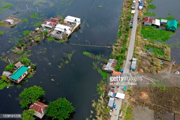 In this aerial photo inundated village houses are seen in Savar on August 19, 2020. - The death toll from the torrential monsoon rains across South...
