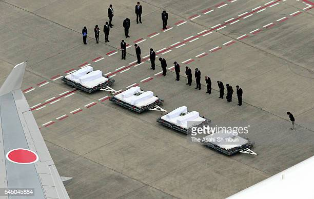 In this aerial photo people are seen taking the moment of silence as the coffins of seven Japanese victims of Dhaka terrorist attack arrive at the...