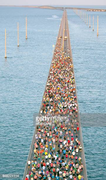 In this aerial photo provided by the Florida Keys News Bureau, about 1,500 runners fan out over Florida Keys waters during the Seven Mile Bridge Run...