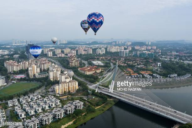 In this aerial photo taken on March 28 2019 hot air balloons fly over Putrajaya during the international hot air balloon festival in Putrajaya