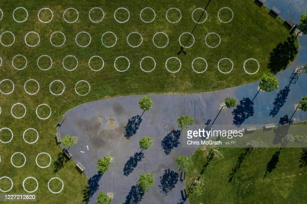 In this aerial photo taken with a drone newly made social distancing circles are seen in a park on the last day of the Muslim holiday of Eid alFitr...