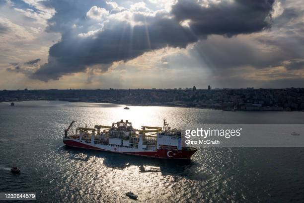 In this aerial photo taken with a drone, Turkish drilling vessel 'Fatih' sails up the Bosphorus towards the Black Sea on May 29, 2020 in Istanbul,...