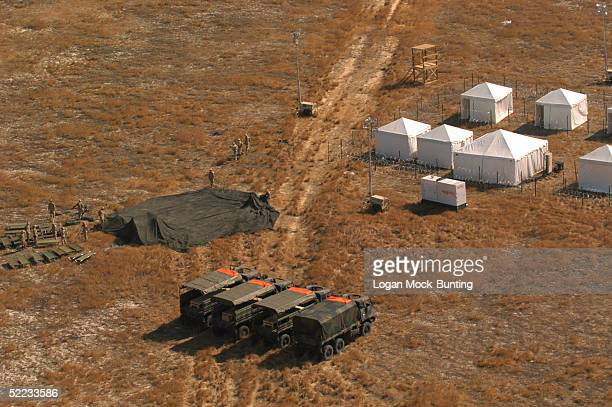In this aerial photo US Army vehicles are parked near mock prison and interrogation center at a front operating base in Braggistan an imaginary...