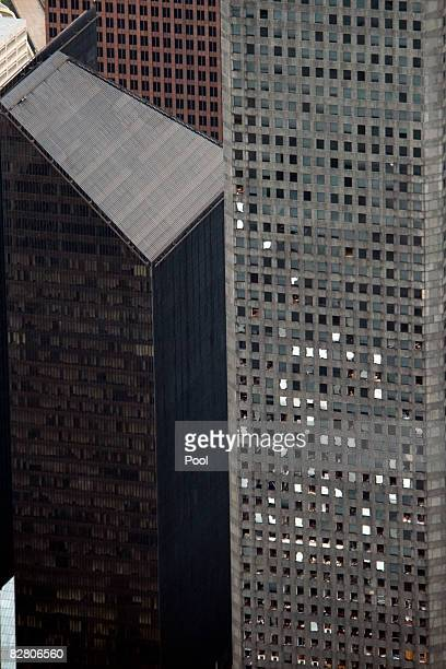 In this aerial photo windows are shown blown out in a skyscraper September 13 2008 in Houston Texas Ike caused extensive damage along the Texas Gold...
