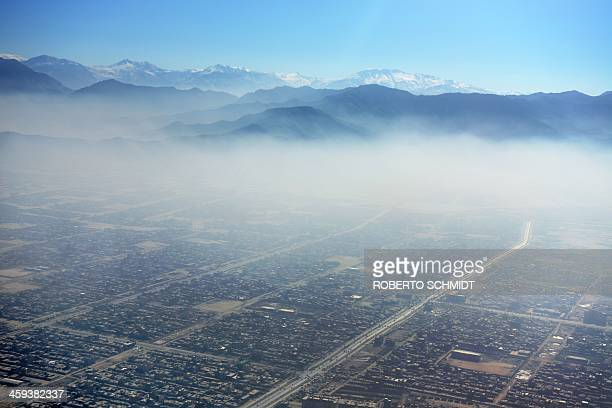 In this aerial photograph a blanket of smog hangs over Kabul city on December 26 2013 The air pollution in the mountain ringed city is felt more...