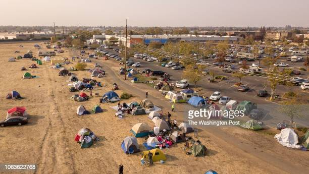 In this aerial photograph an evacuee encampment is seen at a Walmart parking lot in Chico California on November 19 2018