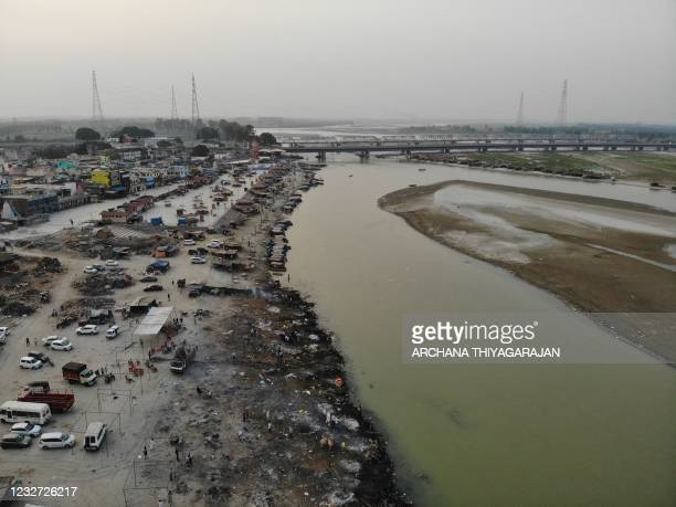 In this aerial photograph taken on May 5, 2021 funeral pyres of Covid-19 coronavirus victims are seen in a cremation ground along the banks of the...