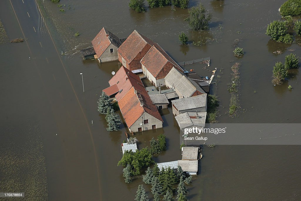 In this aerial view a farm and a road stand partially submerged in floodwaters from the Elbe river on June 12, 2013 near Fischbeck, Germany. The swollen Elbe is continuing to endanger communities along its northern route in Saxony-Anhalt and Brandenburg states, though the bursting of a dyke near Fischbeck has relieved some pressure from towns farther north. Floods have ravaged portions of southern and eastern Germany in the last week, leaving at least eight people dead and forcing tens of thousands to evacuate their homes.