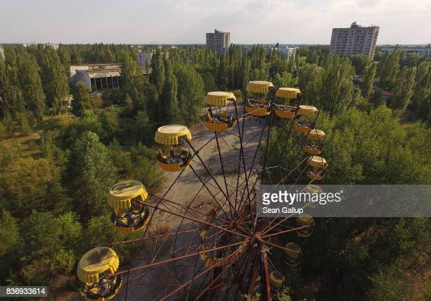 In this aerial view, a ferris wheel stands in the ghost town of Pripyat not far from the Chernobyl nuclear power plant on August 19, 2017 in Pripyat,...