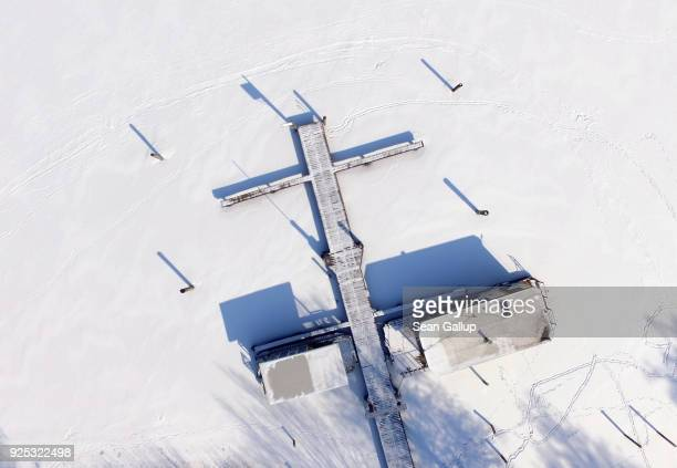 In this aerial view a houseboat lies secured to a small pier on frozen Rheinsberger See lake on February 28 2018 in Warenthin Germany Cold front...