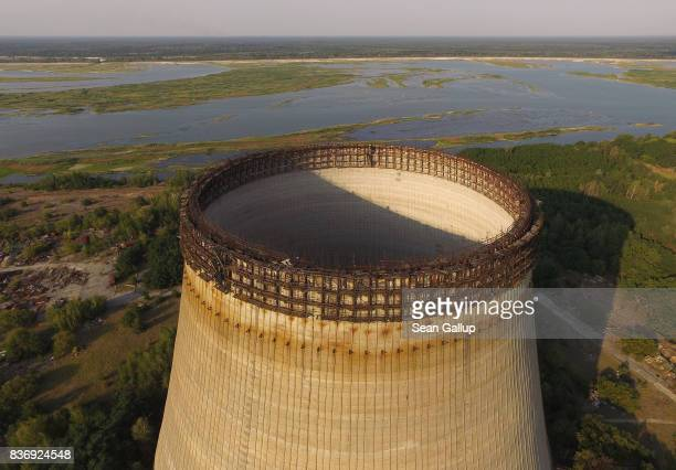 CHORNOBYL' UKRAINE AUGUST 19 In this aerial view a partiallyconstructed and abandoned cooling tower stands at the Chernobyl nuclear power plant as...