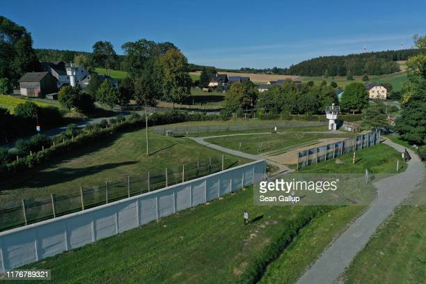 In this aerial view a visitors walk among remnants of the former fortified border between East Germany and West Germany on September 20 2019 in...