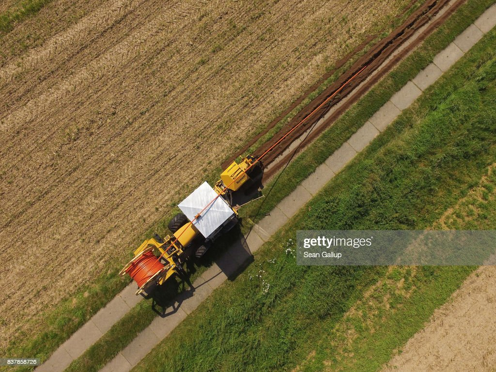 In this aerial view a worker drives a specialzed vehicle that is laying tubing used for running fiber optic cable underground during the installation of broadband infrastructure by a private company called MDDSL on August 23, 2017 near Haldensleben, Germany. The German government is subsidizing efforts to improve broadband access in rural areas. Germany faces elections on September 24 and rural development is a strongly political issue. Many rural areas in Germany, especially in the eastern parts, are facing challenges, especially due to demographics.