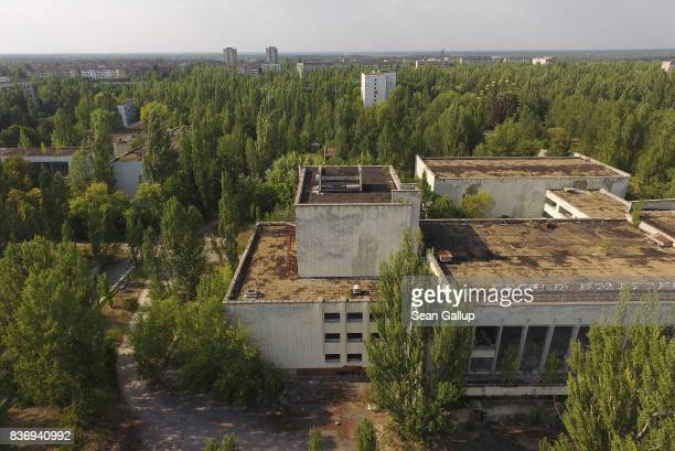 In this aerial view abandoned buildings stand near the main square in the ghost town of Pripyat not far from the Chernobyl nuclear power plant on...