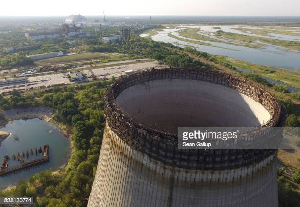 CHORNOBYL' UKRAINE AUGUST 18 In this aerial view an abandoned partiallycompleted cooling towers stand at the Chernobyl nuclear power plant as the new...