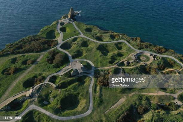 In this aerial view bomb craters lie at La Pointe du Hoc site of a World War IIera German bunker system and the objective of US Rangers during the...