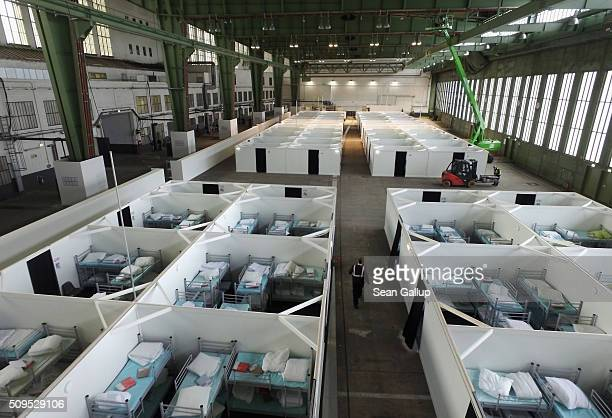 In this aerial view cubicles furnished with bunk beds stand ready to accommodate refugees and asylum applicants in Hangar 6 of former Tempelhof...