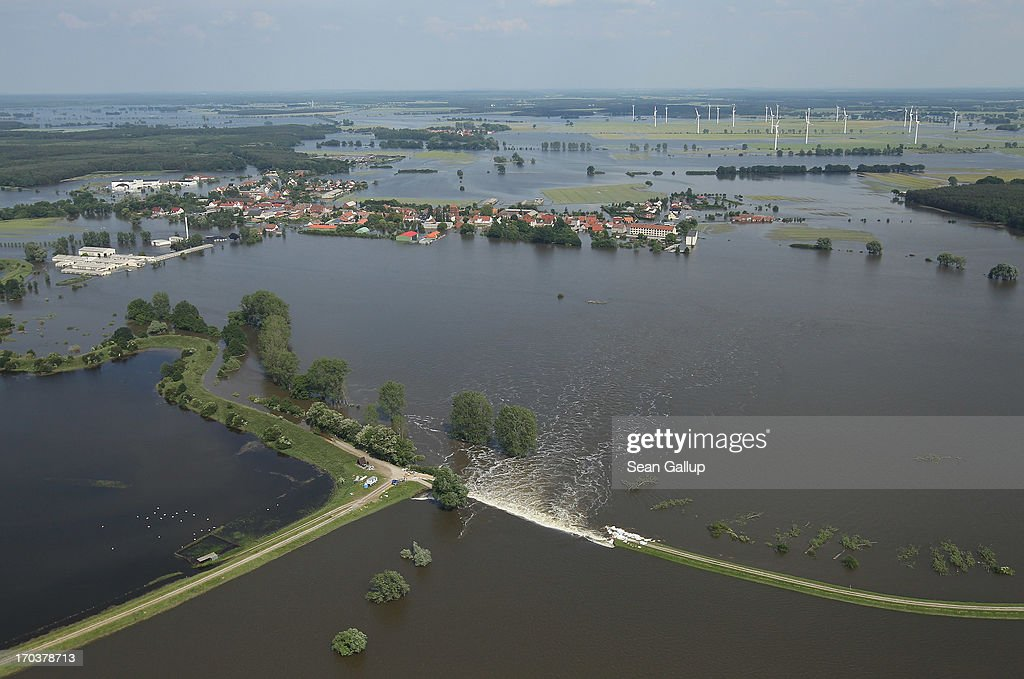In this aerial view floodwater from the Elbe river flows across a burst dyke to flood land and villages on June 12, 2013 at Fischbeck, Germany. The swollen Elbe is continuing to endanger communities along its northern route in Saxony-Anhalt and Brandenburg states, though the bursting of a dyke near Fischbeck has relieved some pressure from towns farther north. Floods have ravaged portions of southern and eastern Germany in the last week, leaving at least eight people dead and forcing tens of thousands to evacuate their homes.