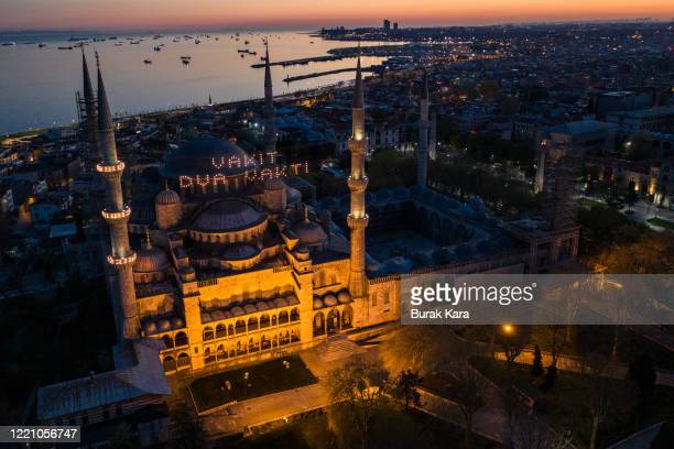 """In this aerial view from a drone, a Ramadan banner seen hanging from the minarets of the Blue Mosque reads in Turkish """"Time to pray"""" on the second..."""