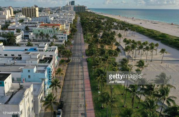 In this aerial view from a drone, desolate Ocean Drive is seen after most visitors have checked out of their hotels in a citywide effort to contain...