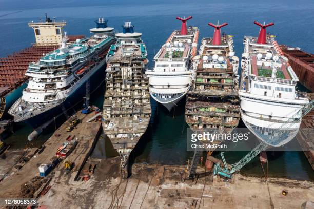 In this aerial view from a drone, five luxury cruise ships are seen being broken down for scrap metal at the Aliaga ship recycling port on October...