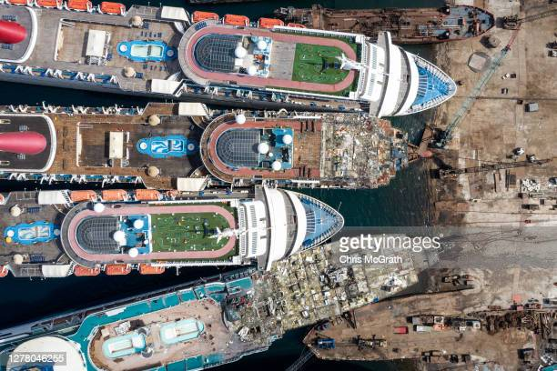 In this aerial view from a drone, luxury cruise ships are seen being broken down for scrap metal at the Aliaga ship recycling port on October 02,...