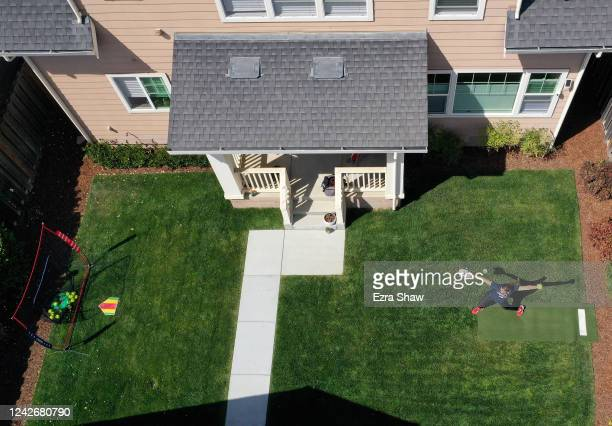 In this aerial view from a drone Olympic softball pitcher Monica Abbott practices in her backyard during a training session on June 02 2020 in...