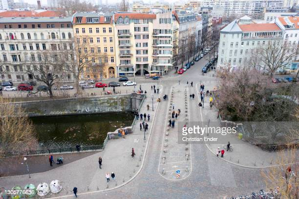 In this aerial view from a drone, people chat at Admiral Bridge at Landwehr canal in Kreuzberg district during the second wave of the coronavirus...