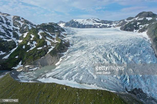 In this aerial view from a drone the Flatbreen glacier lies on a mountain plateau next to a curving moraine it created and from which it has since...