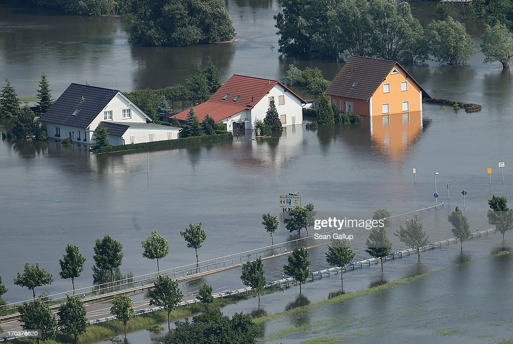 In this aerial view houses and a road stand partially submerged in floodwaters from the Elbe river on June 12, 2013 in Fischbeck, Germany. The swollen Elbe is continuing to endanger communities along its northern route in Saxony-Anhalt and Brandenburg states, though the bursting of a dyke near Fischbeck has relieved some pressure from towns farther north. Floods have ravaged portions of southern and eastern Germany in the last week, leaving at least eight people dead and forcing tens of thousands to evacuate their homes.