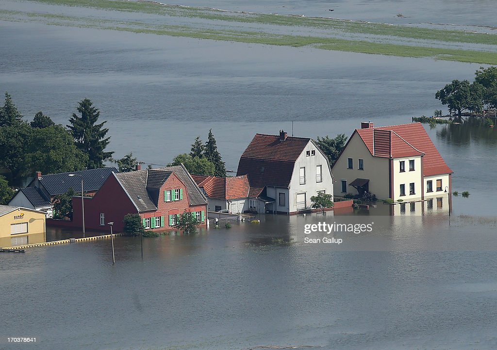 In this aerial view houses stand partially submerged in floodwaters from the Elbe river on June 12, 2013 in Fischbeck, Germany. The swollen Elbe is continuing to endanger communities along its northern route in Saxony-Anhalt and Brandenburg states, though the bursting of a dyke near Fischbeck has relieved some pressure from towns farther north. Floods have ravaged portions of southern and eastern Germany in the last week, leaving at least eight people dead and forcing tens of thousands to evacuate their homes.
