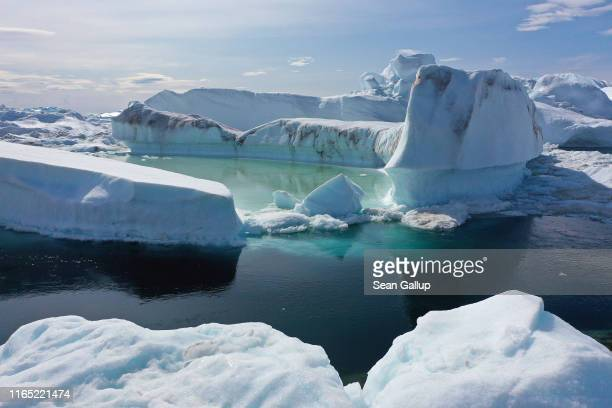 In this aerial view ice floats jammed into the Ilulissat Icefjord during unseasonably warm weather on July 30 2019 near Ilulissat Greenland The...