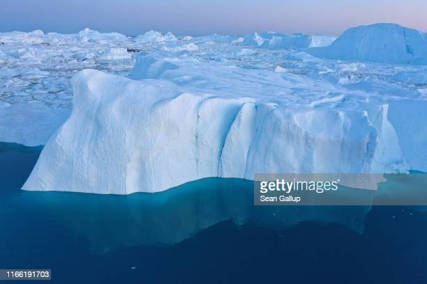 In this aerial view icebergs and ice float jammed into the Ilulissat Icefjord on August 04 2019 near Ilulissat Greenland The Sahara heat wave that...