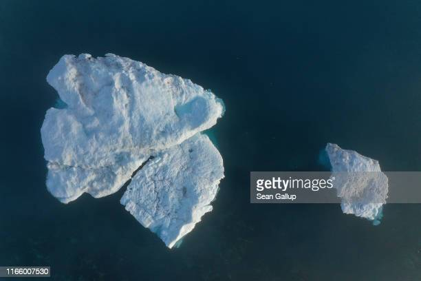 In this aerial view icebergs float in the Ilulissat Icefjord during a week of unseasonably warm weather on August 3 2019 near Ilulissat Greenland The...