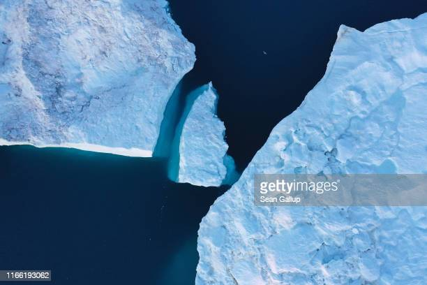 In this aerial view icebergs float in the Ilulissat Icefjord on August 04 2019 near Ilulissat Greenland The Sahara heat wave that recently sent...