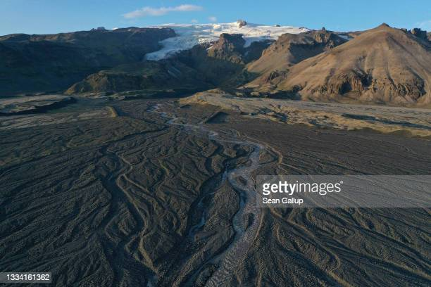 In this aerial view, meltwater descends in shifting rivulets from Vatnajokull ice cap on August 14, 2021 near Hof, Iceland. Iceland is undergoing a...