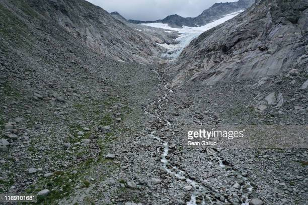 In this aerial view meltwater flows down from the retreating Hornkees glacier through a basin the Hornkees in the early 1900s still filled with ice...