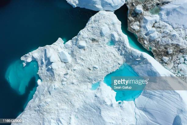 In this aerial view meltwater forms a lake on an iceberg in the Ilulissat Icefjord on August 04 2019 near Ilulissat Greenland The Sahara heat wave...
