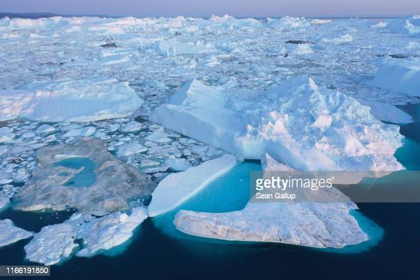 In this aerial view meltwater forms lakes on ice in the Ilulissat Icefjord on August 04 2019 near Ilulissat Greenland The Sahara heat wave that...