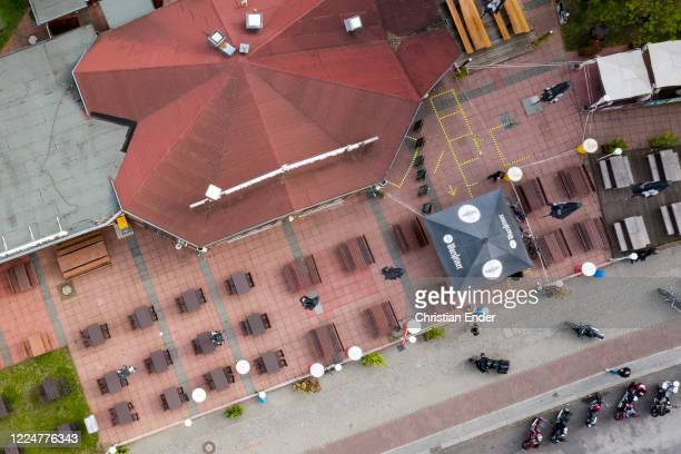 "In this aerial view outdoor tables and chairs stand at a closed beer garden restaurant at the ""Spinnerbruecke"" , a well-known place for bikers,..."