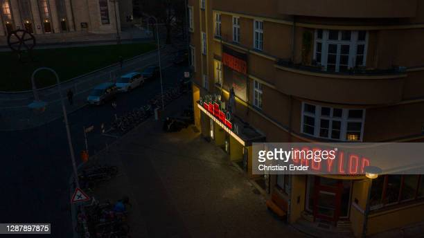 In this aerial view people walk past the Babylon cinema closed under a four-week semi-lockdown during the second wave of the coronavirus pandemic on...