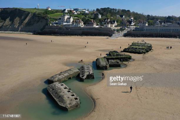 In this aerial view pontoons from the World War II Allied temporary Mulberry harbor built during the D-Day invasion lie on the beach on April 30,...