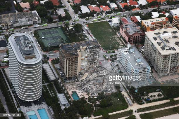 In this aerial view, search and rescue personnel work after the partial collapse of the 12-story Champlain Towers South condo building on June 24,...