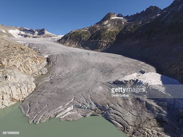 In this aerial view the bottom of the Rhone glacier ends at a small lake created by melting ice near a small portion of the glacier that has been...