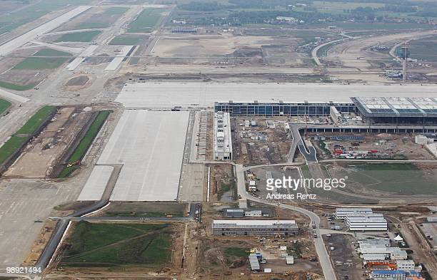 In this aerial view the new main terminal and the construction site of the new Airport Berlin Brandenburg International BBI are pictured on May 8...