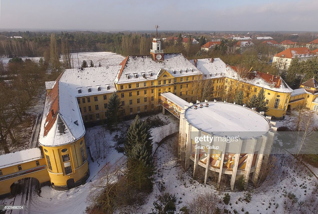 In this aerial view the officers' building and an auditorium stand at the former Soviet military base on January 26, 2017 in Wuensdorf, Germany. Wuensdorf, once called 'The Forbidden City,' was the biggest base for the Soviet armed forces in communist East Germany from 1945 until the last Soviet troops left in the early 1990s following the end of the Cold War and the reunification of Germany. While Soviet troops pulled out of eastern Europe after 1989, Russian troops have in recent years intervened in Ukraine. The NATO military alliance has strengthened its presence in the Baltic states in an effort to prevent similar Russian intervention there.