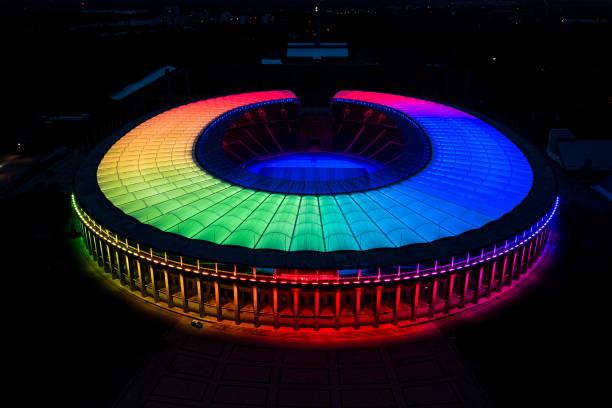 DEU: Olympiastadion Berlin glows in rainbow colors
